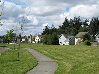 Views of the open space on the Parade Grounds on Bainbridge Island. Many homes line and back to the Parade Grounds.