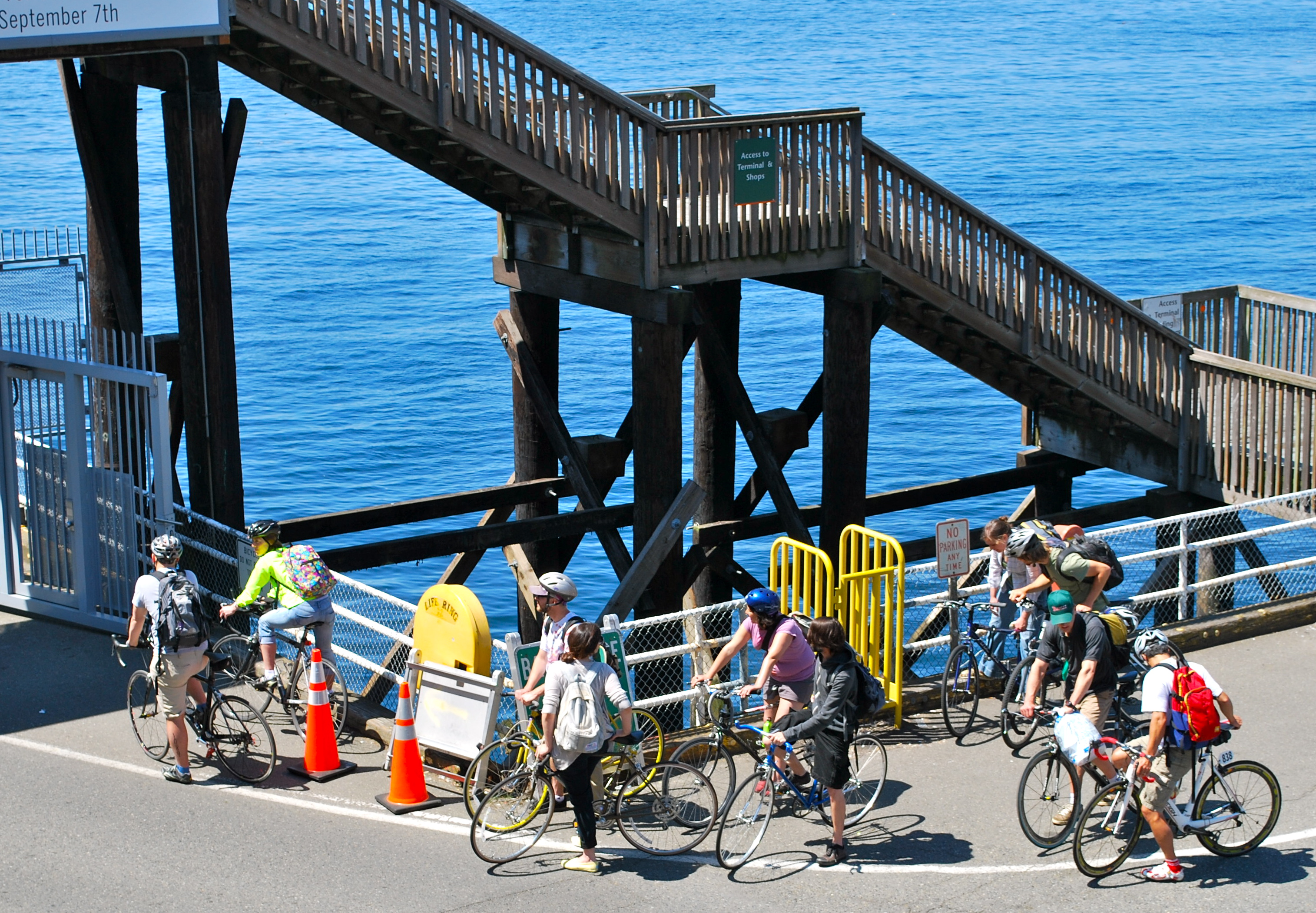 Cyclists getting on the Bainbridge Ferry, Seattle side in summer.