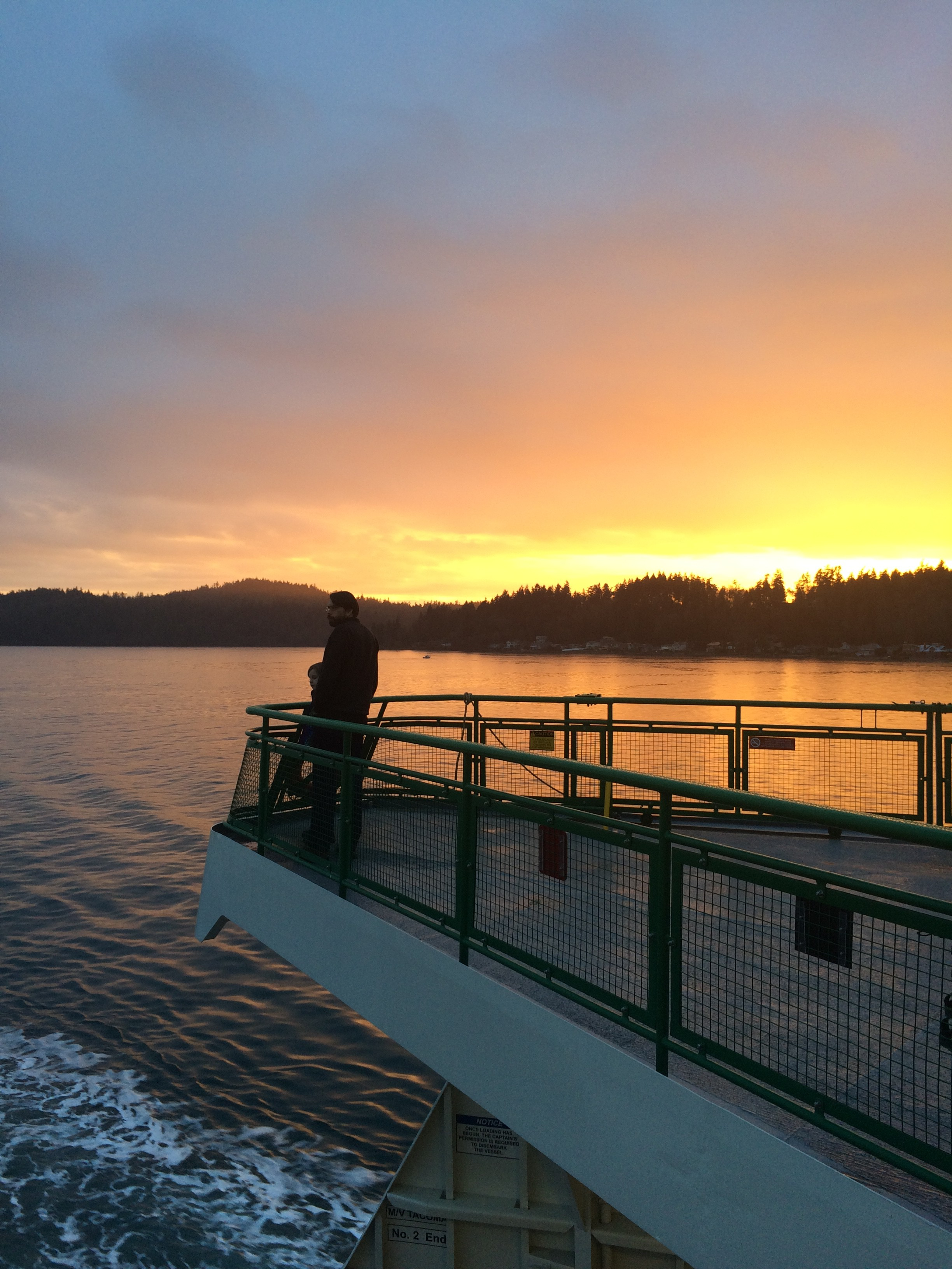 Sunset behind Restoration Point on Bainbridge Island. As seen from the Bainbridge/Seattle Ferry. Jen Pells