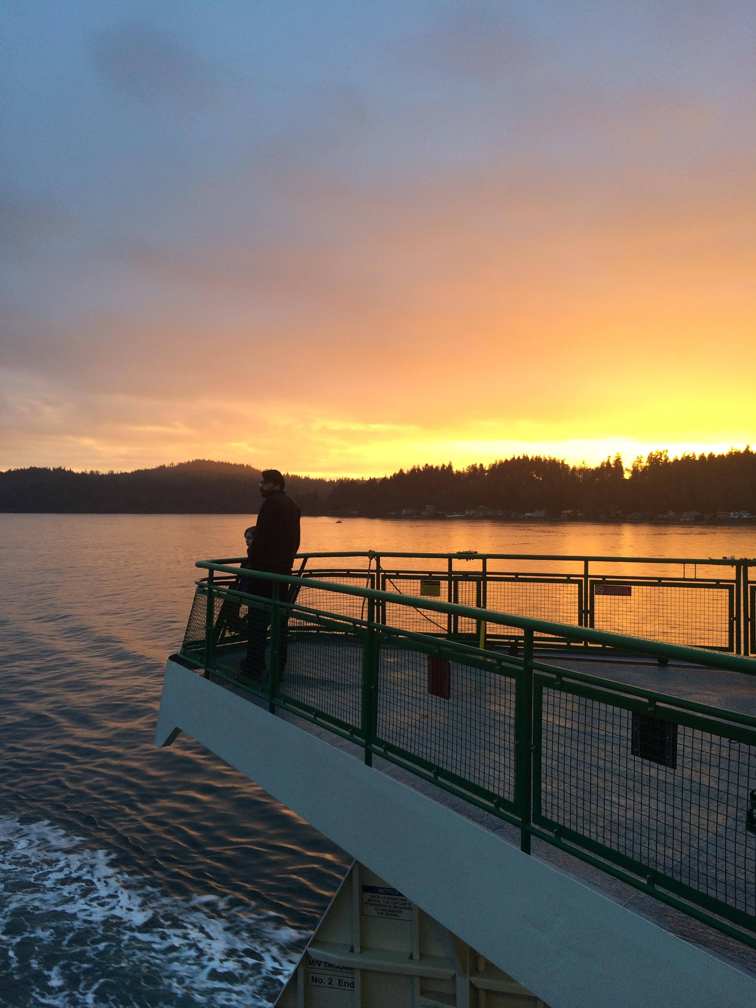 Sunset behind Restoration Point on Bainbridge Island. As seen from the Bainbridge/Seattle Ferry. Jen Pells
